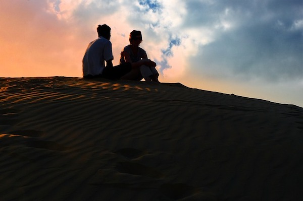 Couple at sunset - https://www.maxpixel.net/Sunset-Dusk-Sky-Desert-Shadow-Silhouette-Human-3193343