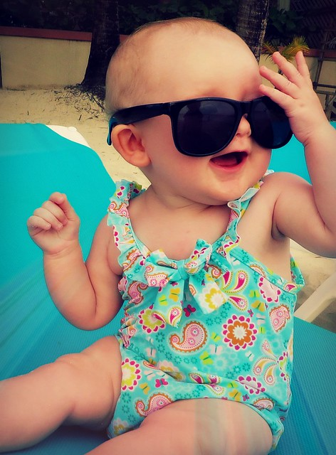 Baby in swimsuit with sunglasses